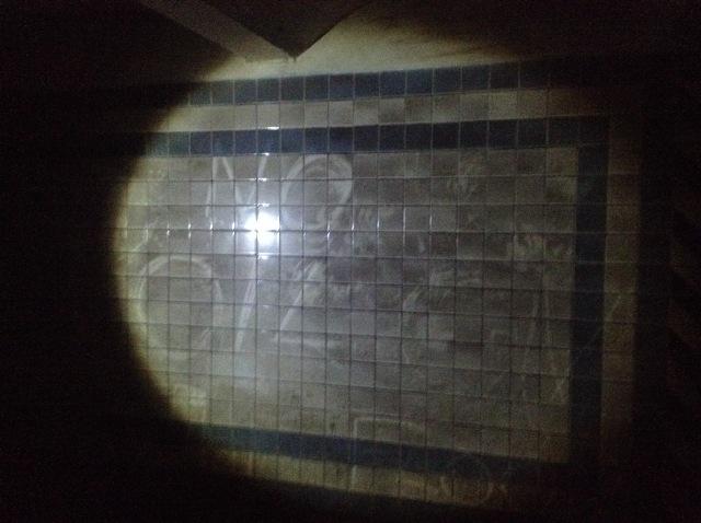 Dust graffiti on the tiles.
