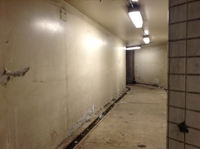 This short tunnel leads to a stairway that took people across the street to the old Parkade building.