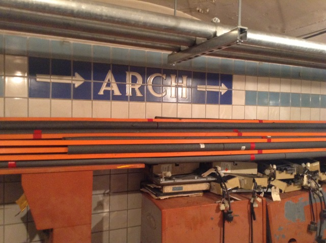 Arch Street tiling continuing south and some old parking lot gates.
