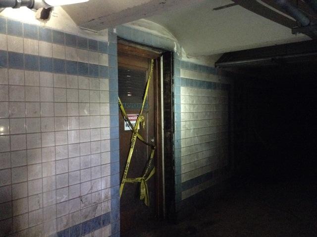Caution-taped transformer room door.