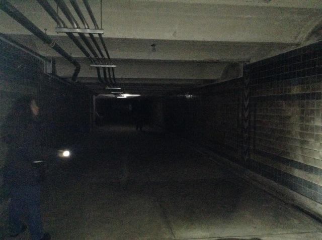 Long pedestrian tunnel to Cooper Street.