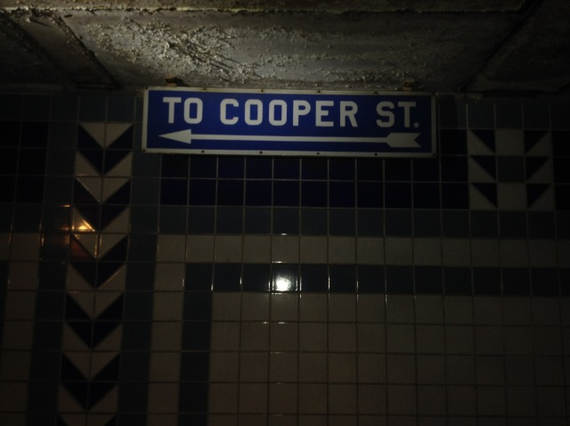 Signage to Cooper Street.