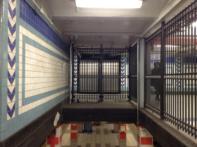 Closed off walkway to Cooper Street as seen from the stairs leading from the platforms.